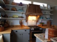 Hand crafted butcher block counter tops add warmth and function!