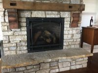 This Century Old Reclaimed Beam, became the mantel to this lakefront homes great room fireplace.
