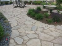Flagstone path wraps around this unique yard