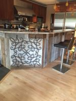 Unique detailed iron accents this kitchen island