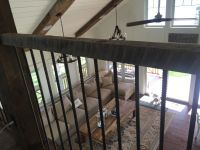 Hribar and vintage barn beams, make up this railing system at this lakefront home.