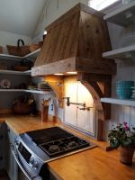 Reclaimed lumber enhances this hand crafted exhaust hood