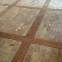 Getting ready for a final cleaning, this office entryway floor was created using Chicago Common bricks and reclaimed lumber.