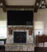 Movie nights and sporting events are enjoyed in front of this northern Illinois lakefront homes massive stone fireplace!
