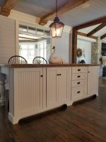 This handmade large Kitchen Island serves many purposes for this large active family