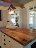 One of many unique details when designing this handcrafted kitchen island, was the choice to use Century Old reclaimed lumber for its top. Both for its warmth and durability.