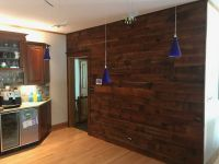Also added was the covering of this accent wall, with the same rich warm pieces of reclaimed lumber