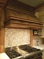 Beautiful custom tile work combine with Century Old Reclaimed Lumber and Barn Beams to make this area a true focal point of this newly remodeled Wisconsin Country Home kitchen.